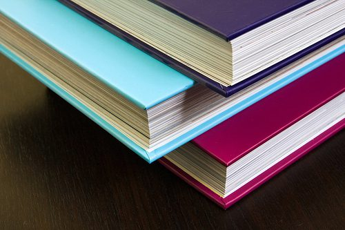 Thick encyclopedias with colorful hardcovers