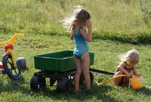 playing in the sprinkler