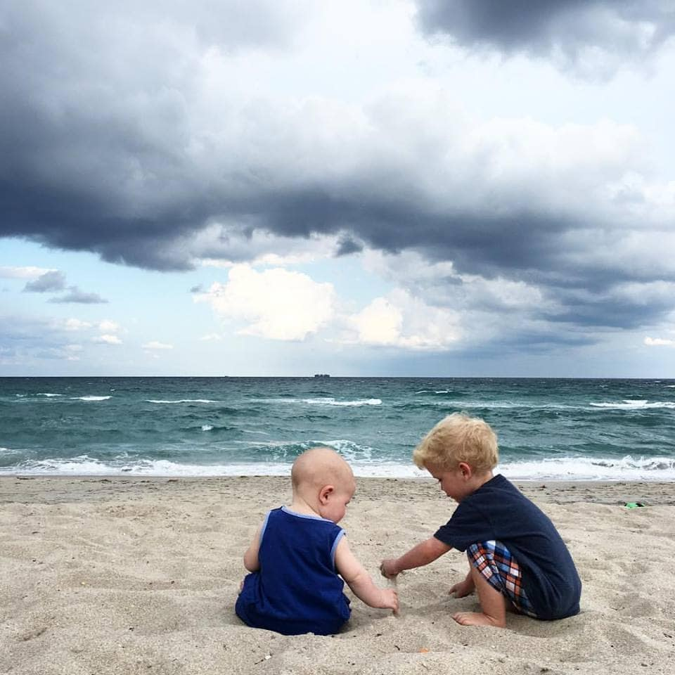 Brothers playing on the beach