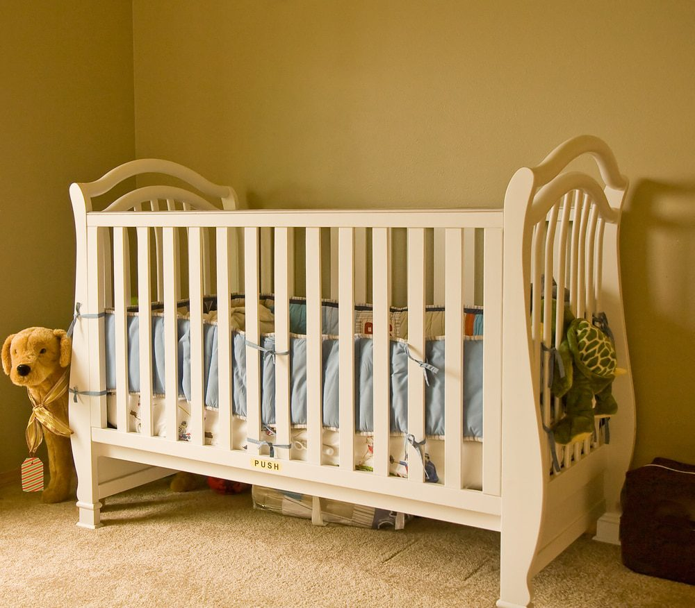 White Crib with Unsafe Crib Bumpers