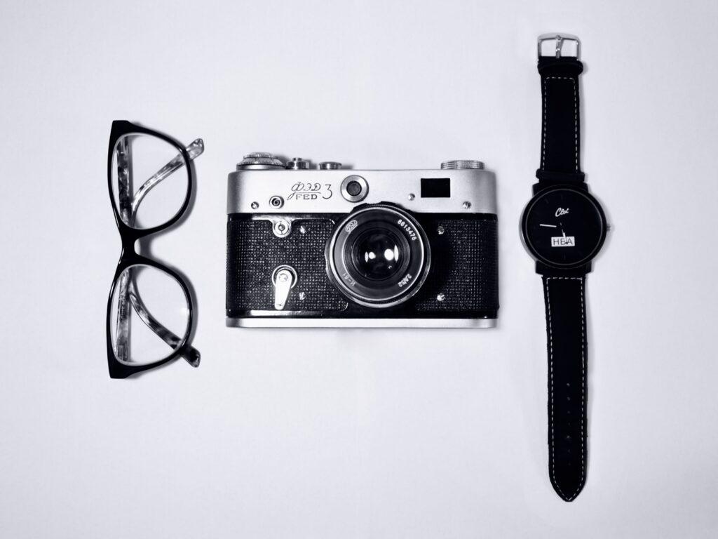 Eye glasses, camera, watch